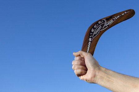 airfoil: Boomerang - Back Soon - A boomerang is a throwing tool, constructed as a flat airfoil, that is designed to spin about an axis perpendicular to the direction of its flight and to return to the thrower. Stock Photo