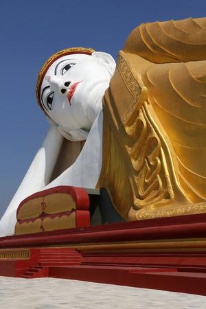 recline: The Reclining Buddha next to the Laykyun Sekkya Standing Buddha near Monywa in Myanmar (Burma). Stock Photo