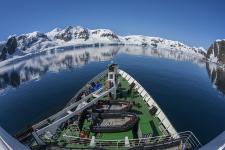 A Russian polar research vessel in Paradise Bay in Antarctica. (Photo taken with an ultrawide fisheye lens) photo