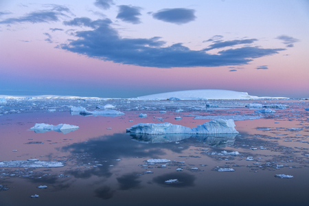 weddell: The Midnight sun over the icebergs in the Weddell Sea near the Antarctic Peninsula in Antarctica. Stock Photo