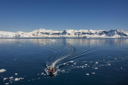 antarctic peninsula: Adventure Tourists in Cuverville Bay on the Antarctic Peninsula in Antarctica.