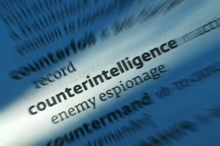 Counterintelligence - Dictonary Definition. Counterintelligence and espionage are activities designed to prevent or thwart spying, intelligence gathering, and sabotage by an enemy. Stock Photo