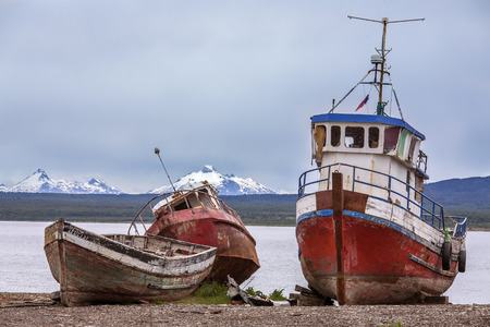 patagonian chile: Old abandoned fishing boats near Puerto Natales in Patagonia in southern Chile, South America. Puerto Natales is located at the opening of Ultima Esperanza Sound 247km (153mls) northwest of Punta Arenas.