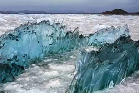 san rafael: Dense, green amorphus glacial ice floating in Laguna San Rafael near the San Rafael Glacier in  in the Northern Patagonian Ice Field in southern Chile, South America.