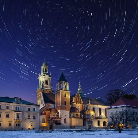 cosmology: Star trails over the Royal Cathedral on Wawel Hill within the grounds of Wawel Castle in Krakow in Poland. The cathedral features the Baroque style chapel of the Vasa family and the renaissance Zyguntowska Chapel whose dome is covered in pure gold.