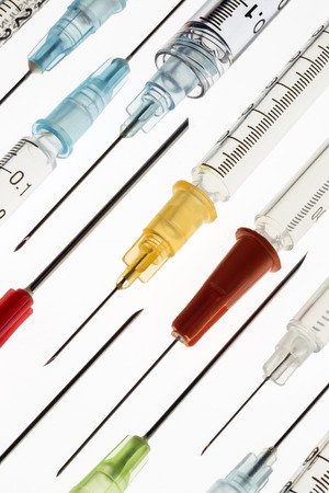 intramuscular: Medical syringes and needles  used for giving injections of drugs in the treatment of illness and disease. Stock Photo