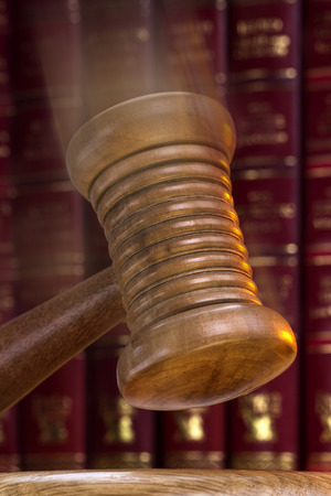 allegation: A gavel is a small ceremonial mallet which an auctioneer, a judge, or the chair of a meeting hits a surface to call for attention or order.