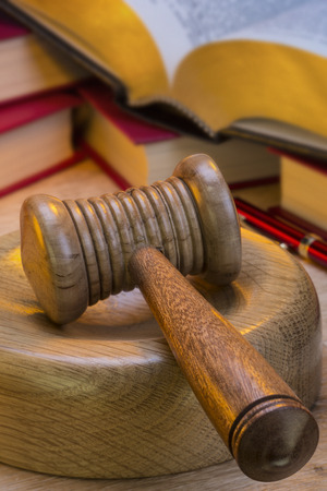 auctioneer: A gavel is a small ceremonial mallet which an auctioneer, a judge, or the chair of a meeting hits a surface to call for attention or order.