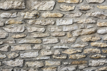 Backgrounds - stone wall on the side of a house built in local Yorkshire Stone - Yorkshire, northeast England.
