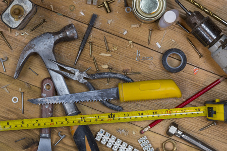 home maintenance: Home maintenance - An untidy workshop bench full of dusty old tools and screws.