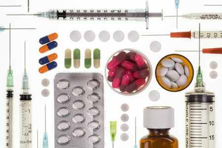 inoculate: Selection of prescription drugs and  syringes used by doctors in the treatment of illness and disease. Stock Photo