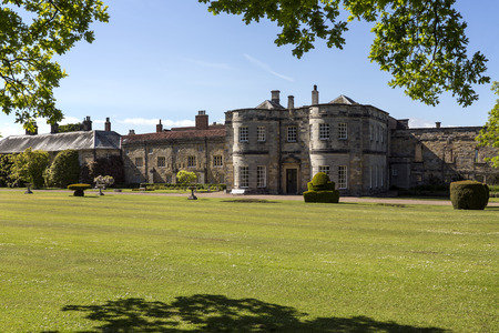stately home: Newburgh Priory is a large country house near Coxwold North Yorkshire England. Standing on the site of an Augustinian priory founded in 1145 it is a stately home in a rural setting with views to the Kilburn White Horse in the distance.