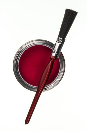 emulsion: Tin of red emulsion paint and a paintbrush