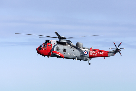 lifesaving: A Royal Navy Search and Rescue helicopter flying off the northeast coast of the United Kingdom. Editorial