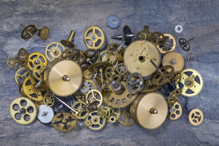 disassemble: Selection of dusty old brass clock parts.