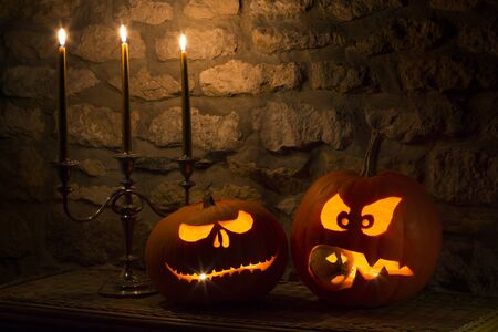 frightening: Spooky Halloween pumpkins - the night of 31st October, the eve of All Saints Day, often celebrated by children dressing up in frightening masks and costumes.