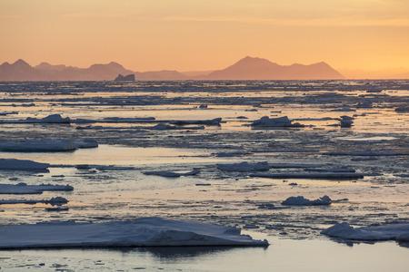 polar environment: Midnight Sun and sea ice of the coast of eastern Greenland.