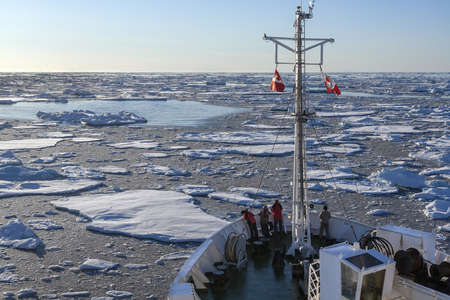 polar environment: A tourist icebreaker and sea ice off the coast of eastern Greenland.