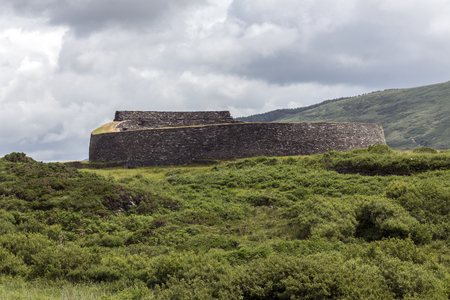lived here: Cahergall Stone Fort near Cahirsiveen in southwest Ireland. This stone fort or Cashel was built as a protected farmstead. It is likely that someone of local importance lived here about a 1000 years ago. Stock Photo