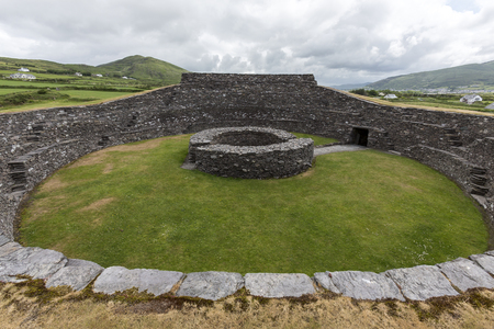 Cahergall Stone Fort near Cahirsiveen in southwest Ireland. This stone fort or Cashel was built as a protected farmstead. It is likely that someone of local importance lived here about a 1000 years ago. Stock Photo