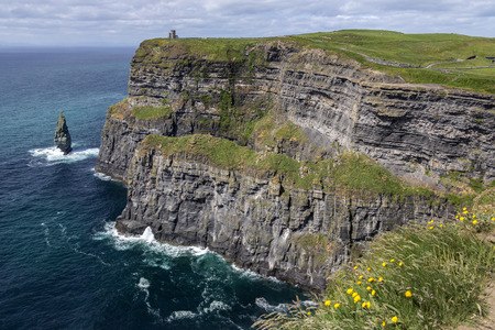 The Cliffs of Moher - located at the southwestern edge of the Burren region in County Clare, Ireland. They rise 120 metres (390 ft) above the Atlantic Ocean at Hags Head and reach their maximum height of 214 metres (702 ft) here just north of OBriens T Stock Photo