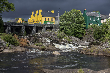county kerry: The village of Sneem on the Iveragh Peninsula in County Kerry in the Republic of Ireland. The River Sneem flows through the village.