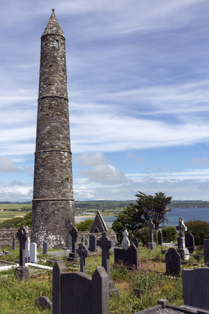 The ruins of Ardmore Cathedral and round tower, County Waterford in the Republic of Ireland. On a hill above the village of Ardmore is a well-preserved 30m, 12th-century round tower and the ruins of a Cathedral dating from the 13th century.