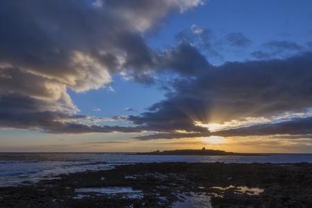 republic of ireland: Sunset over the Atlantic coast at Doolin, a coastal village in County Clare, in the Republic of Ireland.