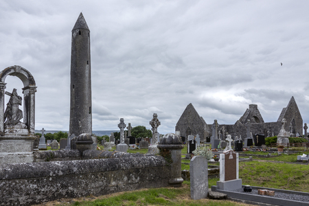 reportedly: Kilmacduagh Monastery and Round Tower - a ruined abbey near the town of Gort in County Galway, Ireland. It was reportedly founded by Saint Colman in the 7th century