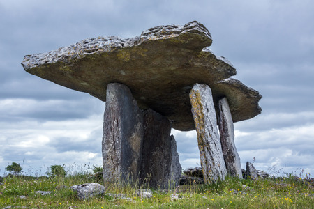 Poulnabrone Prehistoric Dolmen on a limestone plateau on the Burren in County Clare in Ireland. This megalithic tomb was constructed from slabs of limestone over 5000 years ago