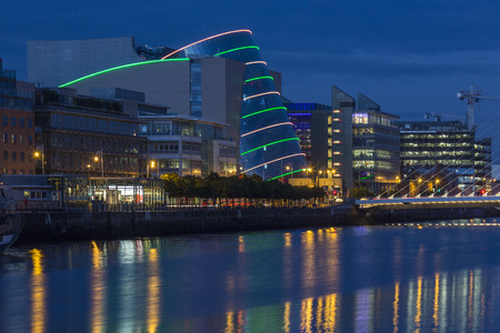 The River Liffey and the building on the waterfront near the Convention Center - Dublin city center in the republic of Ireland. Editorial