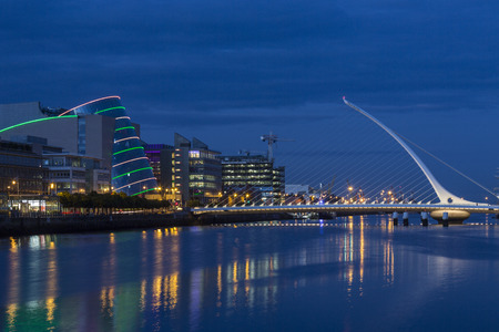 The River Liffey, the Samuel Beckett Bridge and the building on the waterfront near the Convention Center - Dublin city center in the republic of Ireland.