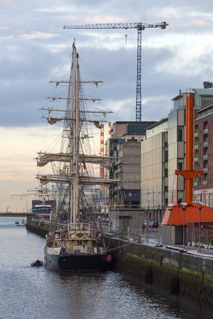 liffey: The sail training ship Lord Nelson moored in the River Liffey in Dublin, Republic of Ireland. Operated by the Jubilee Sailing Trust she is a square-rigged three-masted barque based in Southampton in the south of England. Founded in 1978 with money from th