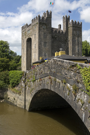 tower house: Bunratty Castle is a large 15th-century tower house in County Clare in the Republic of Ireland. It is located in the center of Bunratty village, the castle dates from 1425. The castle and the adjoining folk park are run by Shannon Heritage as tourist attr