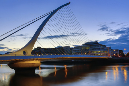joins: The Samuel Beckett Bridge and the building on the waterfront near the Convention Center - Dublin city center in the republic of Ireland. This is a cable-stayed bridge that joins Sir John Rogersons Quay on the south side of the River Liffey to Guild Stree Editorial