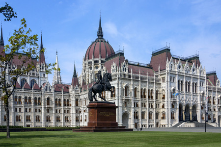The Hungarian Parliament Building in Budapest, Hungary. It is the seat of the National Assembly of Hungary. It lies in Lajos Kossuth Square, on the bank of the Danube. It is currently the largest building in Hungary and is still the tallest building in Bu