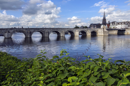View of Maastricht city centre with its medieval bridge over the Meuse river. Maastricht is a town in the southeast of the Netherlands. It is the capital city of the province of Limburg.