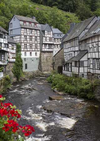 Monschau - A picturesque town in the hills of the North Eifel Nature Park in the narrow valley of the Rur river. The historic town center has many well-preserved half-timbered houses. The narrow streets and many of the buildings have remained largely unch