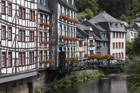 Monschau - The town is located in the hills of the North Eifel, within the Hohes Venn � Eifel Nature Park in the narrow valley of the Rur river. The historic town center has many preserved half-timbered houses and narrow streets have remained nearl Editorial