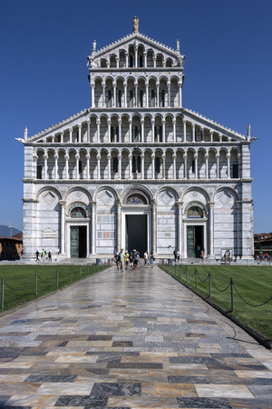 Duomo di Pisa in the city of Pisa in Italy. The Cathedral is located in Piazza dei Miracoli between the Baptistry of St John and the Bell Tower - The Leaning Tower of Pisa. Construction of the Duomo began in 1064 by the architect Buscheto. Editorial