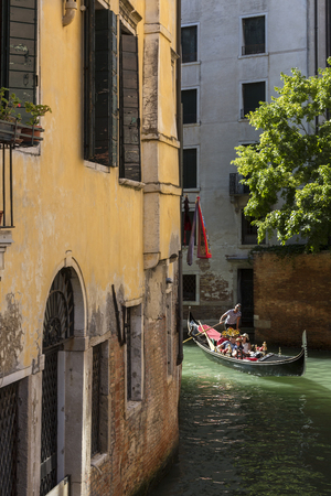 mediterranian: Tourist gondola on a small canal in the city of Venice in northern Italy