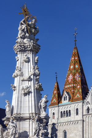 matthias church: Holy Trinity Square and Matthias Church (also called Church of Our Lady of Buda or Matyas Church) in Budapest, Hungary. The Column representing the Holy Trinity dates from 1713 and celebrates the end of the plague outbreak in Budapest. Stock Photo