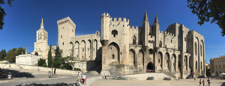 Panoramic view of the Palais des Papes in the city of Avignon in southeast France in the department of Vaucluse on the left bank of the Rhone River. Once a fortress and palace, the papal residence was the seat of western Christianity during the 14th centu Editorial