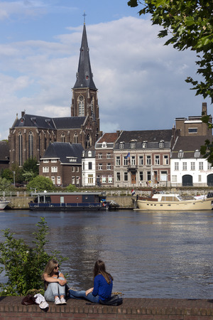 meuse: View across the River Meuse to part of the city of Maastricht in southeast Netherlands. Maastricht is an industrial city and capital of the province of Limburg. It is situated on both sides of the River Maas near the Belgian and German borders.