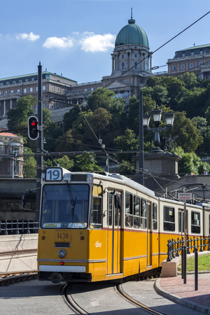 A Ganz CSMG tram near Buda Castle in the city of Budapest in Hungary. In operation since 1866, the Budapest tram network is one of worlds largest tram networks, operating on 156 kilometres (97.46 miles) of track. The system is operated by Budapest Transi
