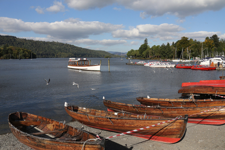 Bowness waterfront at Lake Windermere in the Lake District in Cumbria in the northwest of England in the United Kingdom. Windermere is the largest natural lake in England and is within the Lake District National Park.