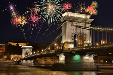 Firework display and the Szechenyi Chain Bridge over the River Danube in the city of Budapest in Hungary.