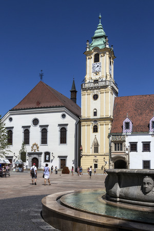 old town hall: Bratislava, Slovakia - August 8, 2016: Fountains and the Old Town Hall buildings in the old town district of Bratislava, the capital city of Slovakia. The Old Town Hall is a complex of buildings from the 14th century. It is the oldest city hall in the c