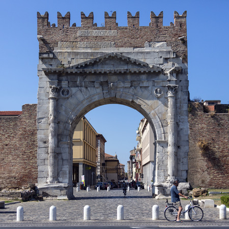The Roman Arch of Augustus, built in 27 BC. Merlons (crenellation) were added to the top in the Middle Ages. It was restored in the 18th century by Tommaso Temanza. Rimini is a city in the Emilia-Romagna region of northern Italy Editorial