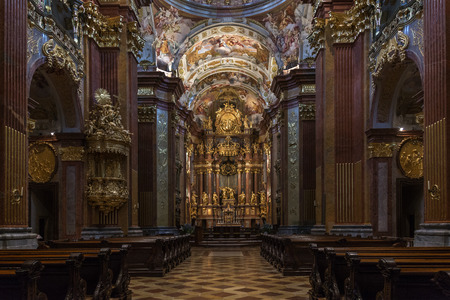 gave: The High Altar in the church inside Melk Abbey - a Baroque Benedictine Monastery on a rocky outcrop overlooking the Danube river at Melk in the Wachau Valley in Austria. The abbey was founded in 1089 when Leopold II, Margrave of Austria gave one of his ca